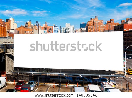 Big Blank Billboard In New York City, Surrounded By Highrise Buildings And A Bright Blue Sky Overhead