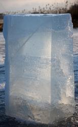 Big block of ice in evening sunlight