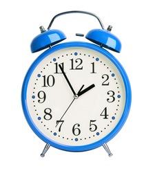 Big blue alarm clock on white background