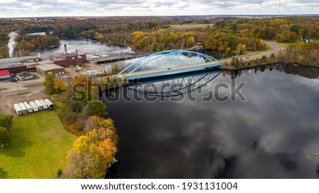 big blue bridge over the chippewa river in cornell wisconsin at Brunet Island State Park Stock photo ©