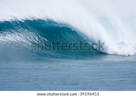 big blue hollow wave with offshore wind breaking on the desert west coast of australia