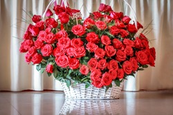 Big bouquet of red roses in the white wattle basket.