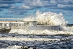 big braking waves during a gale in Kolobrzeg on the coast of the Baltic sea in Poland