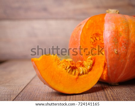 Background Big Bright Orange Ripe Raw Cut Pumpkin With Juicy Texture Full Of