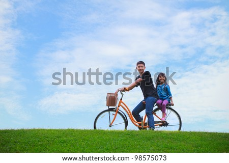 Big brother and young sister with bicycle