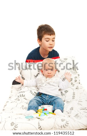 Big brother caring his little sister  isolated on white background
