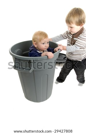 Big brother tries to get rid of little brother by putting him out with the garbage