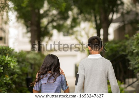 Big brother walking with his sister. Foto d'archivio ©