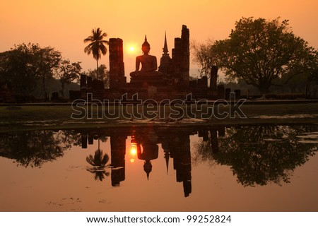 Big Buddha in the sunlight in the evening at Wat Mahathat temple in old Sukhothai capital city in Sukhothai historical park in Northern of Thailand.