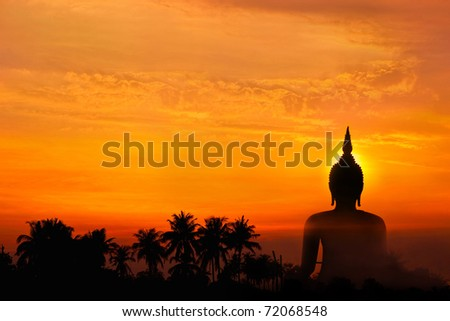 Big buddha statue in sunset