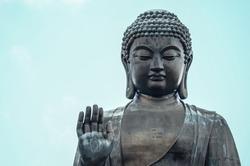 Big buddha statue on the mountain in Hong Kong.
