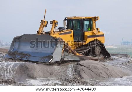 Big bulldozer on the beach