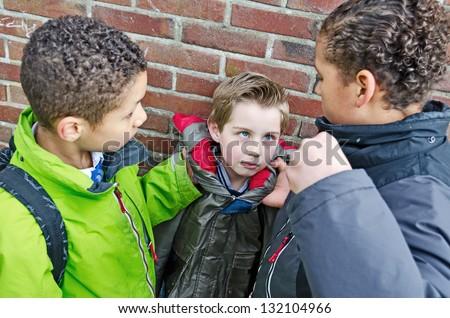 Big bullies taking on small boy