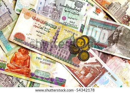 Big bunch of colorful Egyptian banknotes and coins