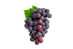 Big bunch of fruit red grapes with green grape leaves on white background