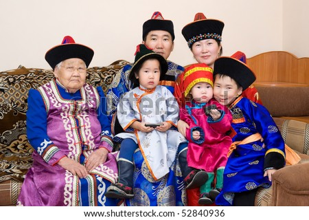 big buryat (mongolian) family: grandmother, grandson with wife and children, in national costumes