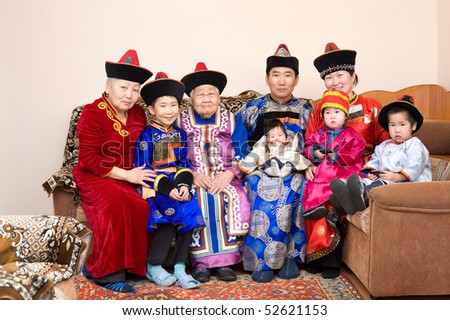 big buryat (mongolian) family: great grandmother, grandmother, son with wife and their children, in national costumes