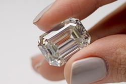 Big Carat Emerald Diamond Holding in Female Hand