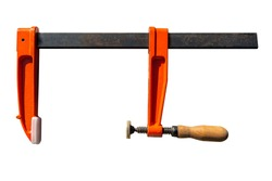 Big carpentry clamp with a wooden grip, isolated on a white background with a clipping path.