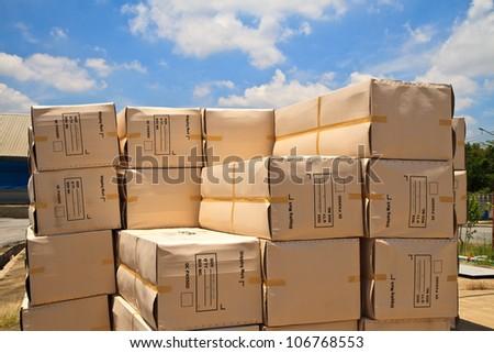 big carton boxes on sky background.
