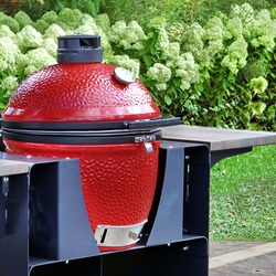Big Ceramic Red BBQ Grill. Barbecue Charcoal Grill For Cookout Food. Ceramic Barbeque Grill And Smoker On The Backyard Lawn Or Restaurant Outdoor Terrace.
