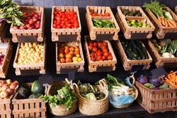 big choice of fresh fruits and vegetables on market counter