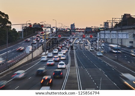 big city highway motor road with heavy traffic of cars and vehicles at sunset blurred lights