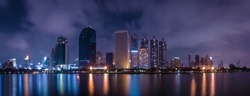 Big city in the night life by using long exposure Technics. Panorama of landscape.Town and urban concept. Landscape and attraction theme.