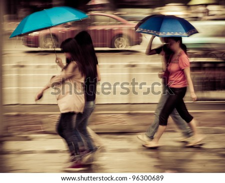 big city people walk on road in rainy day