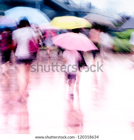 big city people walk on road in rainy day, blured motion abstract background.