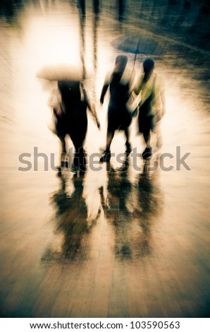 big city people walk on road in rainy day, blurred motion abstract background.