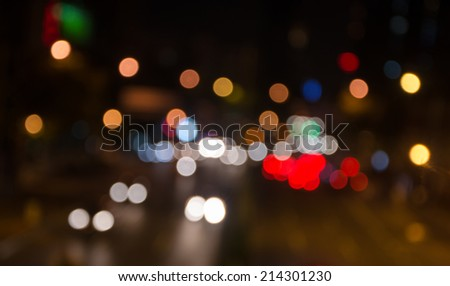 Big city road car lights at night.The out-of-focus light spot..