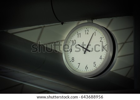 big clock hanging from the...