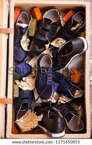 Big collection of different sport shoes,Pile of various men shoes isolated over white, with clipping path. #1171650055