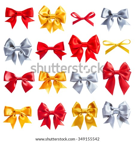 big collection set of red, golden, silver ribbon satin bows isolated on white