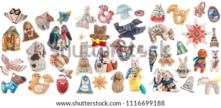 Big Collections toys from fabrics. The toy is made from natural fabrics and hand-painted Ukrainian artists. Isolated on white
