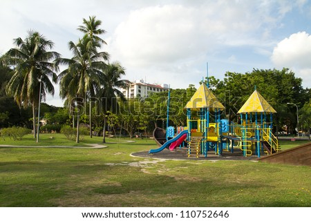 Big colorful children playground equipment in middle of park