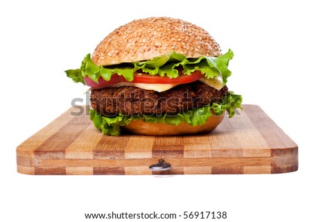 Big colorful hamburger on chopping board  isolated on white