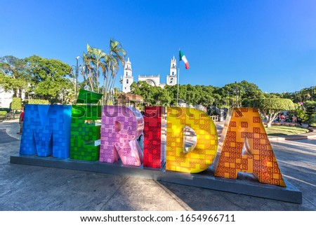 Big colorful letters representing Merida with an iconic Merida Cathedral at the background