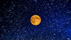 Big colorful moon on the background of stars