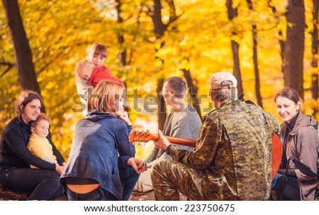 big company at fall season forest picnic