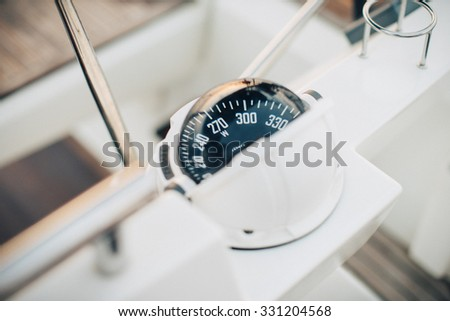 Big compass on a boat showing direction. horizontal