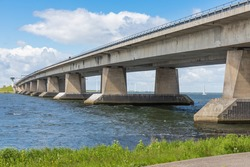 Big concrete bridge over Dutch lake near Lelystad