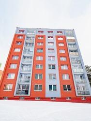 Big condominium apartment block in modern thermal insulation of the facade. Cheap housing. Skyscraper building house.