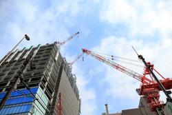 Big construction crane working in big construction site near  Tokyo Japan