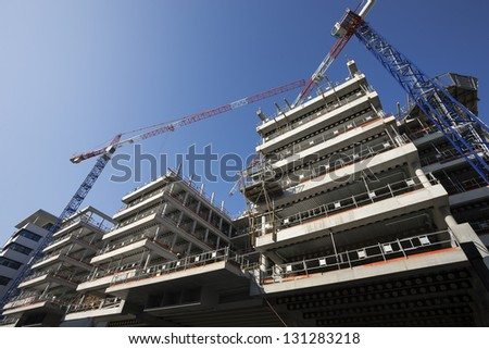 big construction site with cranes and blue sky