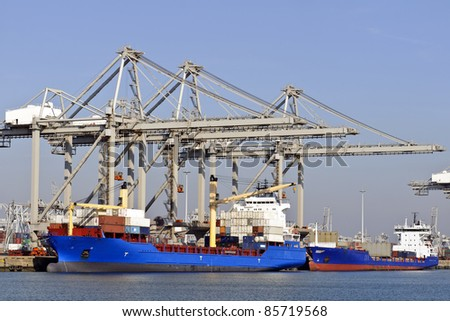 big container ships with cranes in the harbor of rotterdam netherlands