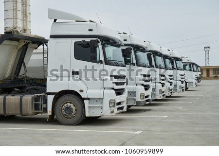 Big container trucks at warehouse building at factory #1060959899