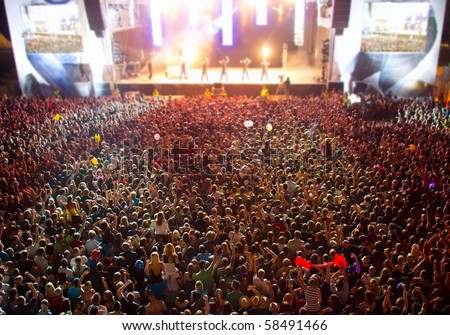 big crowd before stage at a live concert of a famous rockband - stock photo