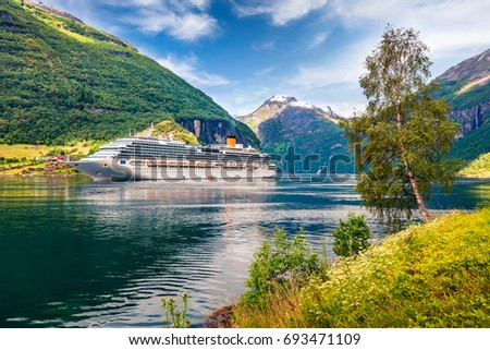 Big cruise ship in Sunnylvsfjorden fjord. Colorful summer morning in Norway, Europe. Traveling concept background. Artistic style post processed photo.
